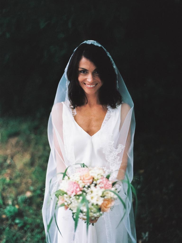 Photo d'une mariée souriante par Michael Ferire