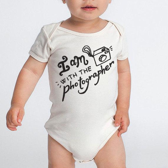 Un body pour bébé dont las parents sont passionnés de photo