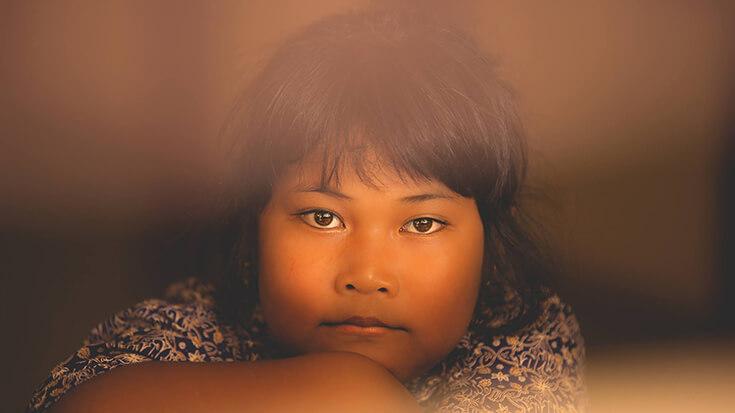 Portrait d'un enfant asiatique, par Olivier Faure
